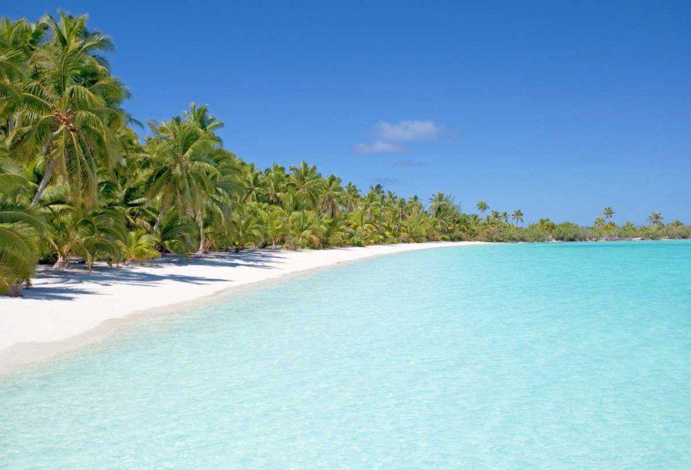 En la Isla Saona el agua cristalina del mar Caribe provoca destellos en el sol y permite a los turistas capturar perfectos recuerdos caribeños.
